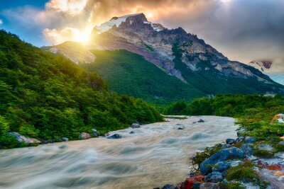 Fototapeta Sun is setting over the mountains and Fitz Roy river at Los Glaciares National Park