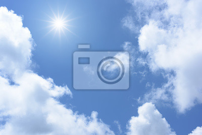 Sun on blue sky with white clouds.
