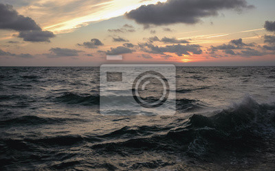 Fototapeta Sunset over rough water of Baltic Sea seen from a tourist boat in Leba town, Poland