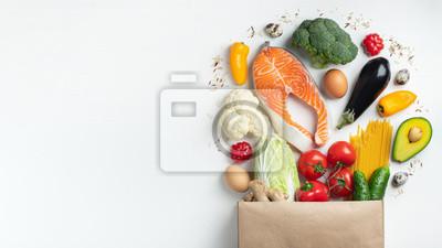 Fototapeta Supermarket. Paper bag full of healthy food.