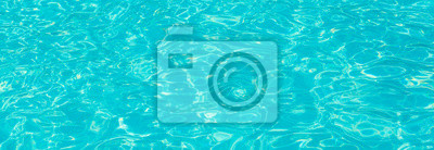 Fototapeta surface of blue swimming pool,background of water in swimming pool.