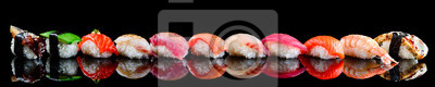 Fototapeta sushi set nigiri on a black background