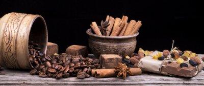 Fototapeta Tabliczka czekolady i przypraw na drewnianym stole