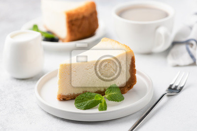Fototapeta Tasty Cheesecake with Coffee on white plate. Cake and coffee. Coffee time. Selective focus