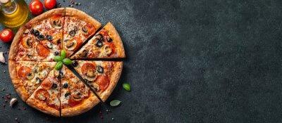 Fototapeta Tasty pepperoni pizza with mushrooms and olives.