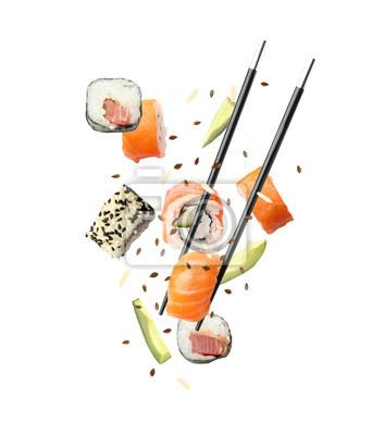 Fototapeta Tasty sushi rolls, avocado and chopsticks on white background
