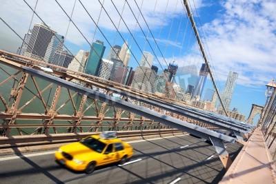 Fototapeta Taxi cab crossing the Brooklyn Bridge in New York, Manhattan skyline in background