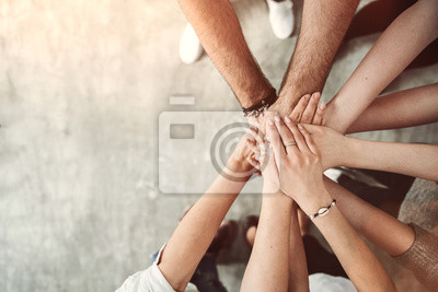 Fototapeta Teamwork, unity concept, group of friends put their hands together with copy space