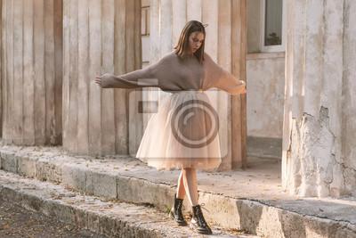 Fototapeta Teen girl in brown tulle skirt and autumn sweater