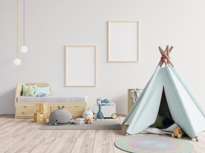 Fototapeta Tent With Toys Against Blank Picture Frames At Home