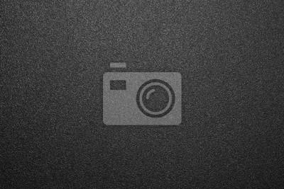 Fototapeta Texture of black matte plastic.Black and white matte background.The background is black rough plastic.