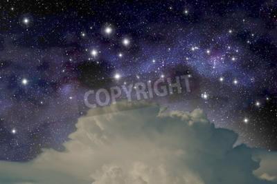 Fototapeta The constellation of the Southern Cross above a cumulonimbus cloud