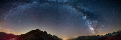 Fototapeta The Milky Way arch starry sky on the Alps, Massif des Ecrins, Briancon Serre Chevalier ski resort, France. Panoramic view high mountain range and glaciers, astro photography, stargazing