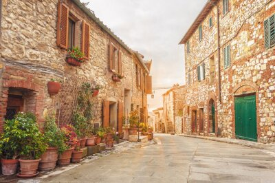 Fototapeta The old Italian town in the colors of spring in Tuscany