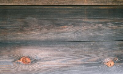 Fototapeta The surface of an old wooden slab house. Old slab texture. Close up brown Wooden planks texture backgrounds