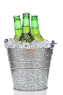 Fototapeta Three Green Beer Bottles in Ice