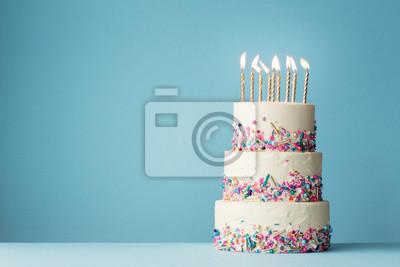 Fototapeta Tiered birthday cake with sprinkles