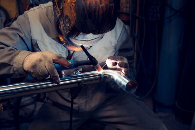 Fototapeta TIG welding of polished stainless steel pipe