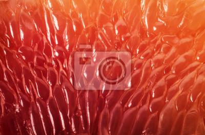 Fototapeta Tło plasterka grejpfruta. Streszczenie makro strzelać.