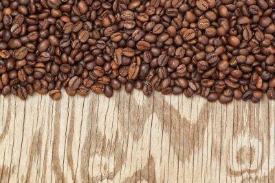 Fototapeta Tło z ziaren kawy i faktur drewna.