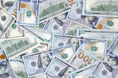 Fototapeta Top view of one hundred dollar banknotes made background. USD currency concept and rich life