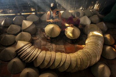 Fototapeta Top view of Two Vietnamese sisters craftsman making the traditional vietnam hat in the old traditional house in Ap Thoi Phuoc village, Hochiminh city, Vietnam, traditional artist concept