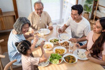 Fototapeta Top view shot of Asian big family enjoy eating food in the kitchen.