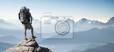 Fototapeta Tourist in mountain peak. Active life concept