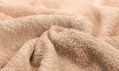 Fototapeta Towel texture closeup. Soft beige color cotton towel backdrop, fabric background. Terry cloth bath or beach towels. Macro image