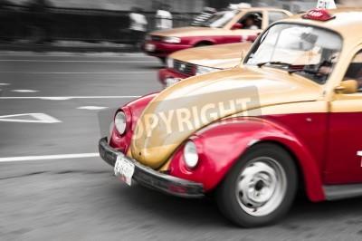 Fototapeta Tradycyjne czerwone i złote taksówki z Meksyku