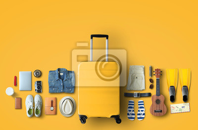 Fototapeta Travel concept with a large suitcase and other accessories