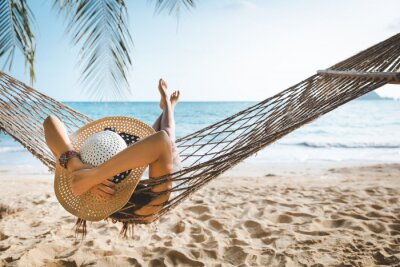 Fototapeta Traveler asian woman relax in hammock on summer beach Thailand