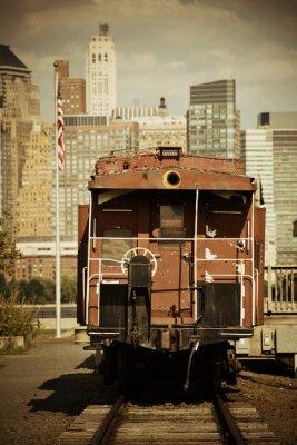 Fototapeta Trenuj i centrum Manhattanu w parku.