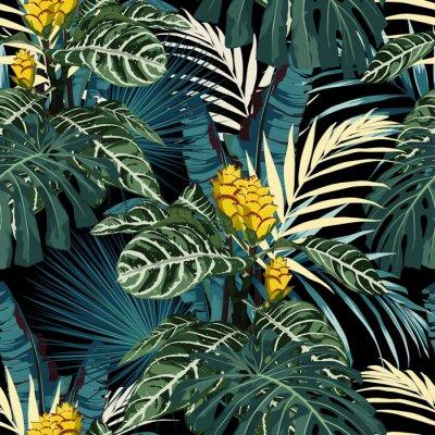 Fototapeta Tropikalny egzotyczny kwiatowy zielony i niebieski monstera palm pozostawia wzór, żółte kwiaty. Tapeta egzotycznej dżungli na czarnym tle.