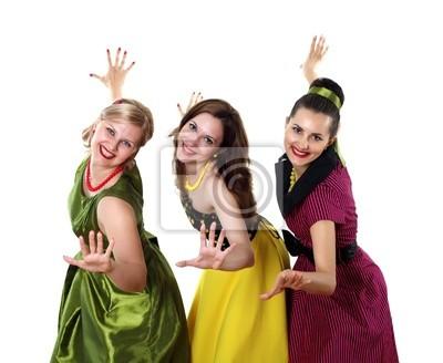 Fototapeta Trzy młode kobiety w jasnych sukienkach kolorów