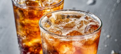 Fototapeta two cups of cold cola soft drink with ice