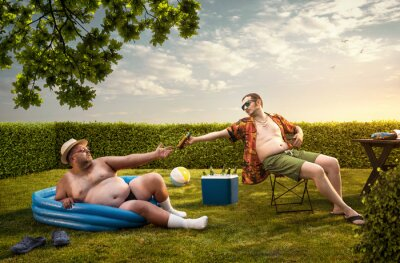 Fototapeta Two funny nerds relaxing in the backyard on the summer day