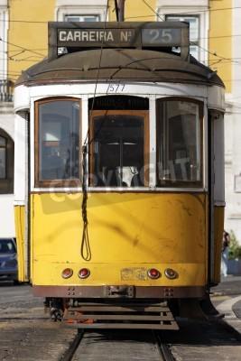 Fototapeta Typical yellow Tram in old street, Lisbon, Portugal