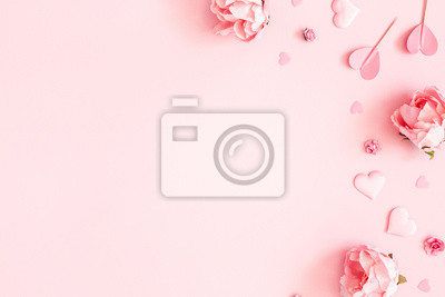 Fototapeta Valentine's Day background. Pink flowers, envelope, hearts on pastel pink background. Valentines day concept. Flat lay, top view, copy space