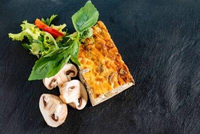 Fototapeta Vegetable casserole  on black