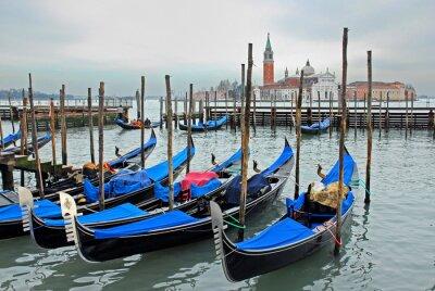 Fototapeta Venice, Italy, gondola parking at sun set.