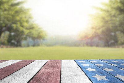 Fototapeta Veterans Day, Memorial Day, Patriot, 4th of July USA flag on table top in the park for background