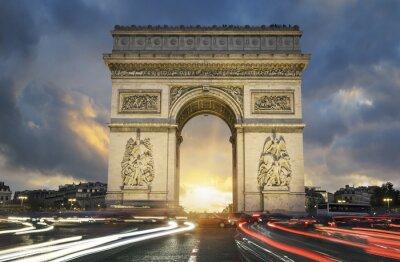 Fototapeta View of famous Arc de Triomphe at sunset