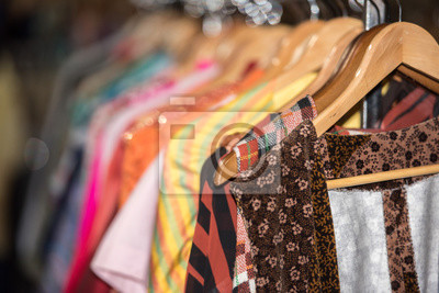 Fototapeta Vintage clothes for sale inside a shop