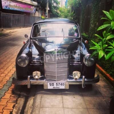Fototapeta Vintage Mercedes Benz car parked in alley