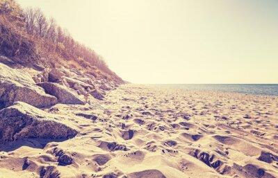 Fototapeta Vintage stonowanych plaży o zachodzie słońca.