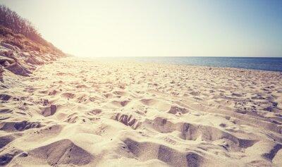Fototapeta Vintage stonowanych plaży o zachodzie słońca, Rewal w Polsce.