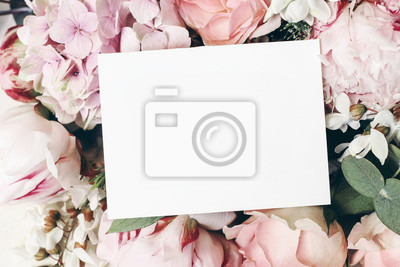 Fototapeta Wedding, birthday stationery mock-up scene. Blank paper greeting card, invitation. Decorative floral composition. Closeup of pink roses petals, peonies, hydrangea flowers and eucalyptus leaves.