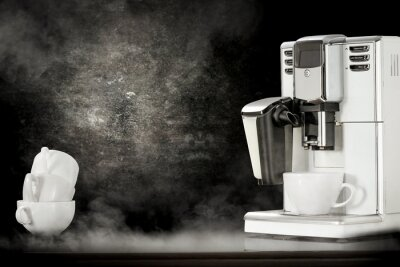 White coffee machine and black background space with smoke