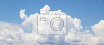 Fototapeta White cumulus clouds formation in blue sky
